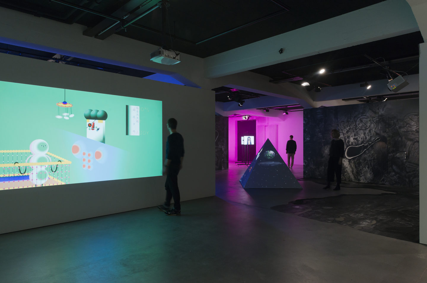 "Installation View Wong Ping ""Who's the Daddy,  2017"" (left), Tabita Rezaire ""Ultra Wet – Rec­apitulation, 2018"", Joey Holder ""The Evolution of the Spermalege, 2018"", !Mediengruppe Bitnik ""Ashley Madison Angels At Work in Basel, 2018"" (on the right)  at HEK, Basel / Photo: Franz Wamhof / Courtesy: the artists"