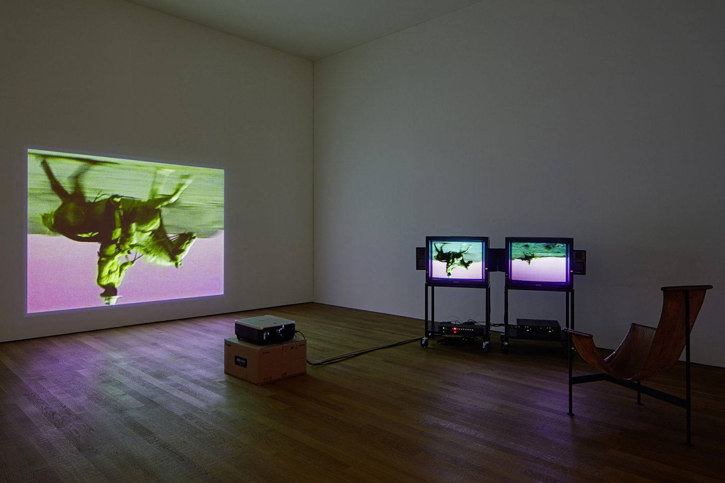 Bruce Nauman: Disappearing Acts, 17 March–26 August 2018, Schaulager® Münchenstein/Basel, installation view with Bruce Nauman, Green Horses, 1988, Two-channel video installation (color, sound), one projection, two monitors, and chair, 59:40 min., continuous play, Purchased jointly by the Albright-Knox Art Gallery, Buffalo, New York, with funds from the Bequest of Arthur B. Michael, by exchange; and the Whitney Museum of American Art, New York, with funds from the Director's Discretionary Fund and the Painting and Sculpture Committee, 2007, © Bruce Nauman / 2018, ProLitteris, Zurich, photo: Tom Bisig, Basel
