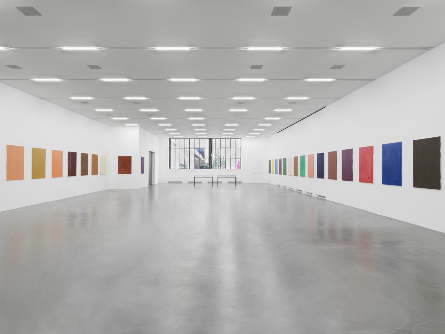 Maria Eichhorn, 72 Bilder (1992–93), 72 monochrome painted canvases, name tags, labeling on the reverse side of the canvases, each 123 x 93 cm, vitrine, Sammlung Migros Museum für Gegenwartskunst, photo: Stefan Altenburger Photography, Zurich © ProLitteris, Zürich