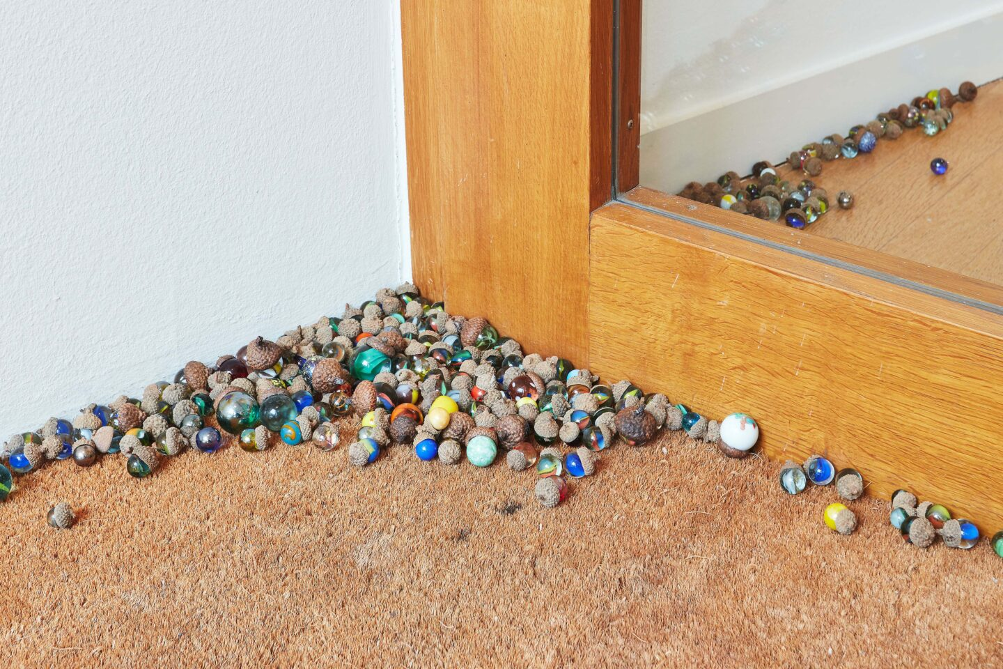 Exhibition View Groupshow «Motor; view on Aline Zeltner, untitled, marbles in acorn hats, variable dimensions, 2020» at Kunstraum Riehen, Riehen, Basel, 2020 / Photo: Moritz Schermbach / Courtesy: the artist