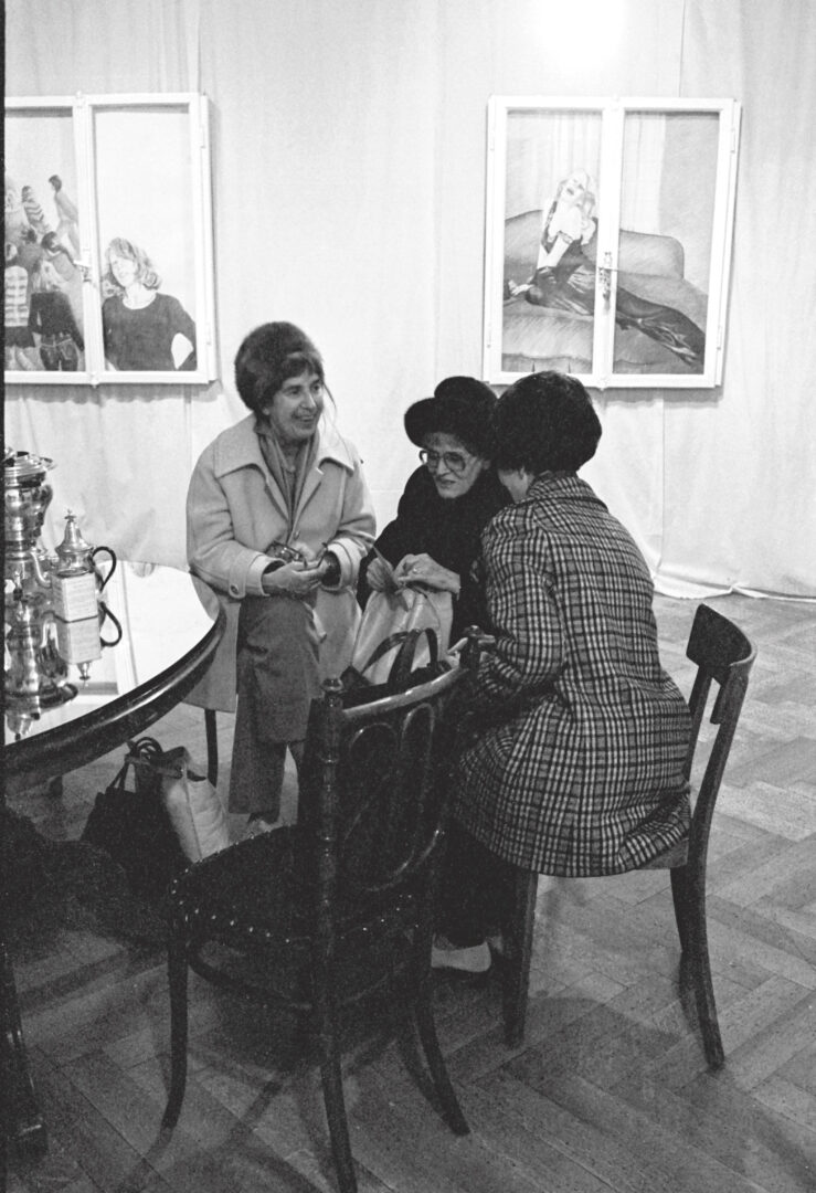 Exhibition View Groupshow «Ausbruch & Rausch, Zurich 1975-1980, Women Art Punk; view on visitors with two window paintings by Cristina Fessler in the background / Photo: Ruth Vögtlin, 1975» at Strauhof, Zurich, 2020